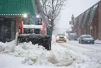Laconia Public Works Dan Camire and Tyler Smith get an early start to stay ahead of the storm clearing the walkways throughout downtown Laconia Thursday morning.  (Karen Bobotas/for the Laconia Daily Sun)