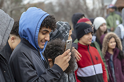 March 22, 2019 - Hamtramck, Michigan, U.S. - Hamtramck, Michigan - A young man in Hamtramck studies his cell phone. Hamtramck has always been a city of immigrants, most recently from Muslim countries. Over 30 languages are spoken in the city. (Credit Image: © Jim West/ZUMA Wire)