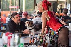 Ed Rieken (subject of Early Morning photograph) and his dog Jaxon as Jaxon get some attention from Cheryllynn Cyr at the Broken Spoke during the Daytona Bike Week 75th Anniversary event. FL, USA. Tuesday March 8, 2016.  Photography ©2016 Michael Lichter.Broken Spoke Saloon during the Daytona Bike Week 75th Anniversary event. FL, USA. Tuesday March 8, 2016.  Photography ©2016 Michael Lichter.