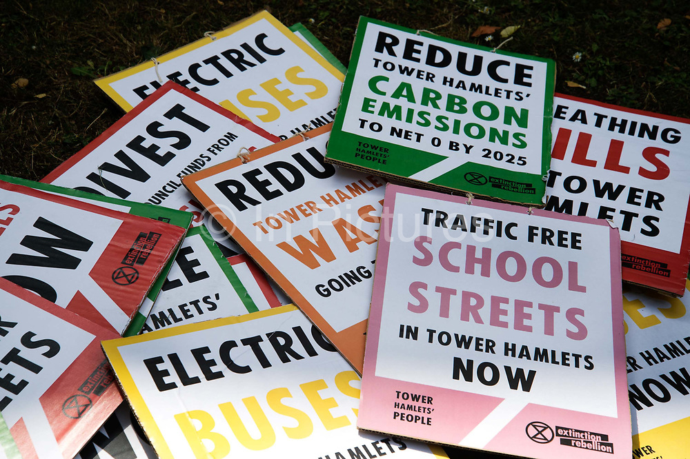 The Air that we Grieve march on July 12th 2019 in East London, United Kingdom. Organised by Extinction Rebellion to draw attention to air pollution and the climate emergency. Placards demanding environmental change in Tower Hamlets.