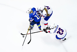 Iceland's Sunna Bjorgvinsdottir and Slovenia's Pia Pren (left) battle for the puck during the Beijing 2022 Olympics Women's Pre-Qualification Round Two Group F match at the Motorpoint Arena, Nottingham.