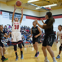 Mya Belen (30) of Crownpoint grabs the offensive rebound as Thoreau defenders watch in  Crownpoint on Thursday. Crownpoint won 66-58.