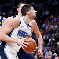 11 November 2017: Orlando Magic center Nikola Vucevic (9) drives past Denver Nuggets center Nikola Jokic (15) during the Denver Nuggets 125-107 victory over the Orlando Magic, at the Pepsi Center, Denver, Colorado, USA.