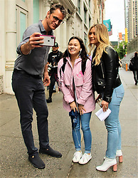 EXCLUSIVE: Hilary Duff, who announced her engagement to Matthew Koma yesterday, is spotted with Younger co-star, Peter Hermann on the way to set. The pair kindly stopped to take a quick photo with happy fan. 10 May 2019 Pictured: Hilary Duff and Peter Hermann. Photo credit: KAT / MEGA TheMegaAgency.com +1 888 505 6342