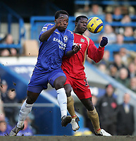 Photo: Lee Earle.<br /> Chelsea v Portsmouth. The Barclays Premiership. 25/02/2006. Chelsea's Michael Essien (L) battles with Benjani Mwaruwari.