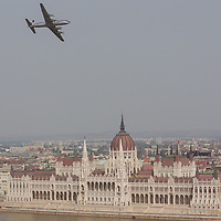 Airplane flies in front of the Hungarian Parliament during an air show above river Danube crossing central Budapest, Hungary on May 01, 2013. ATTILA VOLGYI