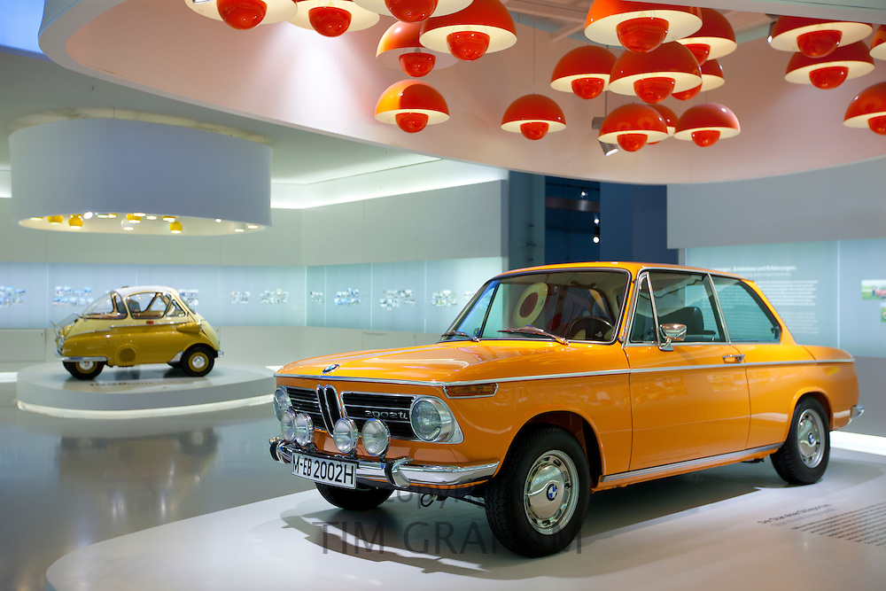 BMW 2002 TI car and Bubble Car on display at the BMW Museum and Headquarters in Munich, Bavaria, Germany