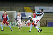 Bolton Wanderers Ricardo Santos (5) Scunthorpe United Abo Eisa (11) battles for possession during the EFL Sky Bet League 2 match between Scunthorpe United and Bolton Wanderers at the Sands Venue Stadium, Scunthorpe, England on 24 November 2020.