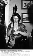 Countess of Lichfield with her shoe on a stick. Party given by Mrs. Homayoun Mazandi. Chester Sq. London. 6 May 1982. Film 82343f5<br />