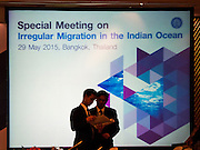 """29 MAY 2015 - BANGKOK, THAILAND:  Delegates talk in front of the video screen before the opening of  the """"Special Meeting on Irregular Migration in the Indian Ocean."""" Thailand organized and hosted the meeting at the Anantara Siam Hotel in Bangkok. The meeting brought together representatives from the 5 countries impacted by the boat people exodus: Thailand, Malaysia and Indonesia, which have all received boat people, and Myanmar (Burma) and Bangladesh, where they are coming from. Non-governmental organizations, like the International Organization for Migration (IOM) and UN High Commissioner for Refugees (UNHCR) as well as countries responding to the crisis, like the United States, also attended the meeting. A total of 22 organizations attended the one day conference.     PHOTO BY JACK KURTZ"""