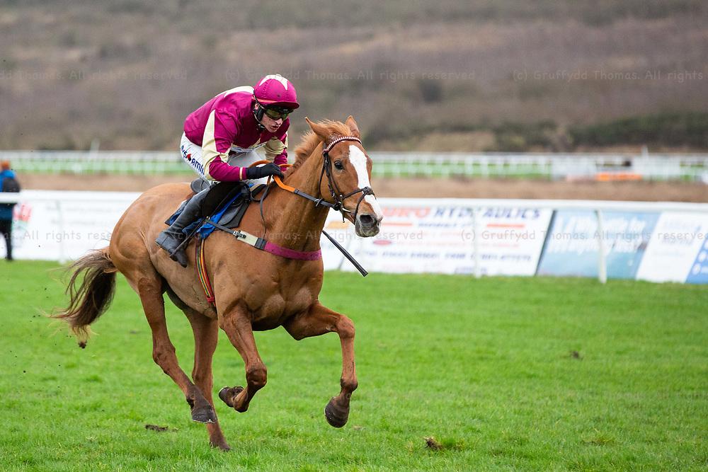 Ffos Las Racecourse, Trimsaran, Wales, UK. Monday 14 January 2019. Colonel Custard (jockey Tom O'Brien) on the way to winning the Walters Group Novices' Hurdle (Race 2)