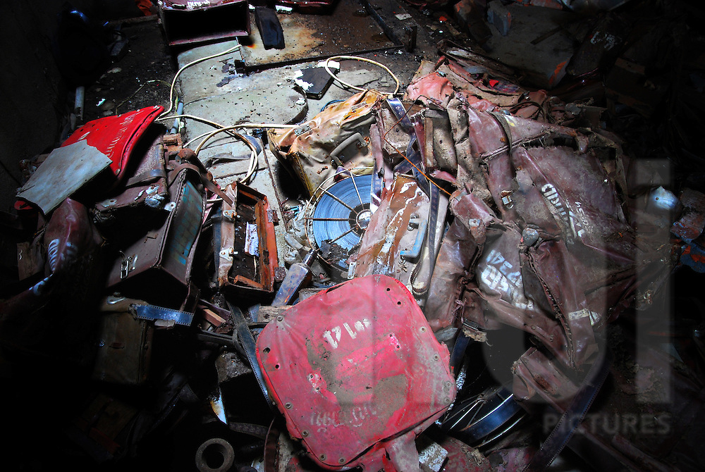 Trash lays on the ground in the abandoned cinema of Bouasavanh, Vientiane, Laos, Asia. Leather cases and film strips are in decay condition.