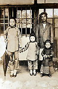 mixed Japanese and Chinese family portrait early 1900s