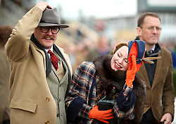 Racegoers react watching the Ballymore Novices' Hurdle during Ladies Day of the 2018 Cheltenham Festival at Cheltenham Racecourse.