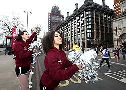 Cheerleaders shout encouragement to the runners during the 2018 London Landmarks Half Marathon. PRESS ASSOCIATION Photo. Picture date: Sunday March 25, 2018. Photo credit should read: John Walton/PA Wire