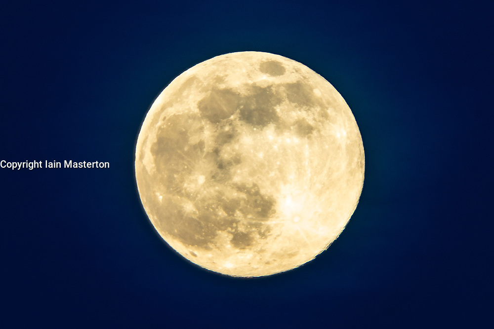 Edinburgh, Scotland, UK. 7 April 2020. Supermoon as seen from Calton Hill in Edinburgh. Tonight the full Moon is at perigee — the closest point in the Moon's orbit to Earth, making it appear bigger and brighter in the sky. Pictured. Close up of the  Supermoon. Iain Masterton/Alamy Live News
