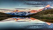 Mt Aspiring, moonrise over Cascade saddle tarn, Mount Aspiring National Park, Otago, New Zealand.