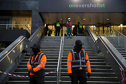 © Licensed to London News Pictures. 03/02/2021. London,UK. Activists are staging a new protest at the offices of HS2. Bailiffs work to evict a group of eco-activists who are living in increasingly unstable tunnels beneath Euston Square Gardens in central London. The eviction of the HS2 Rebellion group from the square began one week ago and continues today.  Photo credit: Marcin Nowak/LNP