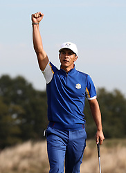 Team Europe's Thorbjorn Olesen celebrates victory on the 14th during the Singles match on day three of the Ryder Cup at Le Golf National, Saint-Quentin-en-Yvelines, Paris.