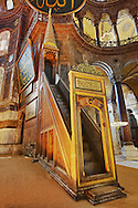 The 19th century minbar (mimbar or mimber)  pulpit  where the imam  stood to deliver sermons or in the Hussainia where the speaker sits and lectures the congregation. Hagia Sophia ( Ayasofya ) , Istanbul, Turkey .<br /> <br /> If you prefer to buy from our ALAMY PHOTO LIBRARY  Collection visit : https://www.alamy.com/portfolio/paul-williams-funkystock/hagia-sophia-istanbul.html<br /> <br /> Visit our TURKEY PHOTO COLLECTIONS for more photos to download or buy as wall art prints https://funkystock.photoshelter.com/gallery-collection/3f-Pictures-of-Turkey-Turkey-Photos-Images-Fotos/C0000U.hJWkZxAbg