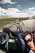 Mongolia is a trekker's paradise, with virtually unlimited possibilities of remote treks. Camping is available anywhere as land-ownership is impossible in Mongolia. Mareile in the back of a truck, while hitch hiking.
