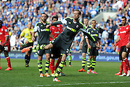 Stoke city's Peter Crouch has a shot at goal. Barclays Premier league match, Cardiff city  v Stoke city at the Cardiff city stadium in Cardiff, South Wales on Saturday 19th April 2014. pic by Andrew Orchard, Andrew Orchard sports photography,