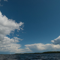 Thunderheads tower over islands amidst Lake of the Woods,  Ontario, Canada.