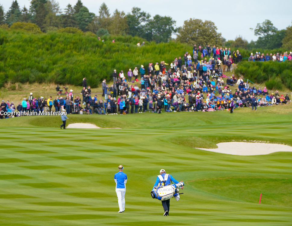 Auchterarder, Scotland, UK. 15 September 2019. Sunday Singles matches on final day  at 2019 Solheim Cup on Centenary Course at Gleneagles. Pictured; Charley Hull of Team Europe walks to 9th green towards large group of spectators. Iain Masterton/Alamy Live News