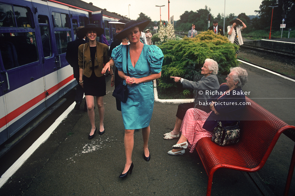 Women watch other ladies arriving from London to attend Royal Ascot Ladies' Day, the annual event on the English sporting and social calendar in June, on 18th June 1992, in Ascot, England.