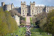 People walk on the long walk towards Windsor Castle on Sunday, April 11, 2021, after the announcement of the death of Britain's Prince Philip on Friday. Britain's Prince Philip, the irascible and tough-minded husband of Queen Elizabeth II who spent more than seven decades supporting his wife in a role that most defined his life, died on Friday. (Photo/ Vudi Xhymshiti)