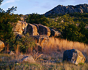 Oak forest and mixed grass prairie on the rocky slopes of Elk Mountain, Charons Garden Wilderness Area, Wichita Mountains National Wildlife Refuge, Oklahoma.