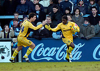 Photo: Richard Lane.<br />Wycombe Wanderers v Oxford United. Coca Cola League 2. 25/02/2006. <br />Oxford's Yemi Odubade (R) celebrates his goal with Tim Sills.