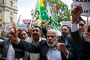 Demonstration to free Kashmir in Westminster on 3rd September 2019 in London, United Kingdom. Kashmiris waving flags gathered in Parliament Square in protest at Indian Prime Minister Narendra Modi's removal of the special autonomous region rights of Kashmir.
