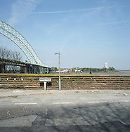 A road running next to the Silver Jubilee road bridge in Runcorn which crosses the river Mersey to Widnes. The Mersey is a river in north west England which stretches for 70 miles (112 km) from Stockport, Greater Manchester, ending at Liverpool Bay, Merseyside. For centuries, it formed part of the ancient county divide between Lancashire and Cheshire.