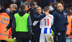 Brighton & Hove Albion manager Chris Hughton (centre) and Anthony Knockaert celebrates after the final whistle during the Emirates FA Cup, third round match at the Vitality Stadium, Bournemouth.