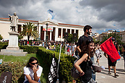 Students prepare to demonstrate outside Athens University against austerity measures and planned education reforms in Athens. The demonstration is against an education reform bill which aims to improve the operation of universities.