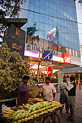 A street vendor sells corn near the Brigade Road shopping and commercial area in Bangalore, India