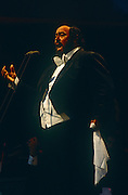 Italian operatic tenor Luciano Pavarotti performs in London during the free Party in the Park concert to celebrate his 30 years in opera<br /> on 30th July 1991 in London's Hyde Park. A crowd of 100,000 stood in the rain to watch Pavarotti perform 20 arias by Verdi, Puccini, Bizet and Wagner. VIPs the Princess of Wales, Prime Minister John Major and Michael Caine were soaked in heavy rain along with everyone else sitting on the grass cowering beneath tarpaulins. Pavarotti helped bring an otherwise high-brow artform to the ordinary Man after the BBC used his rendition of Nessun Dorma to theme their World Cup TV coverage.