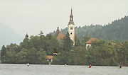 Bled, Slovenia, YUGOSLAVIA.    general View of the Rowing Course used for the 1989 World Rowing Championships, single men's sculling race passing Church, Island, Lake Bled. [Mandatory Credit. Peter Spurrier/Intersport Images]