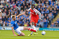 Portsmouth Defender, Matt Clarke (5) tackles Fleetwood Town Forward, Devante Cole (44) during the EFL Sky Bet League 1 match between Portsmouth and Fleetwood Town at Fratton Park, Portsmouth, England on 16 September 2017. Photo by Adam Rivers.