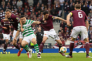 Tom Rogic of Celtic gets a handful of Ryan Edwards of Hearts shirt during the William Hill Scottish Cup Final match between Heart of Midlothian and Celtic at Hampden Park, Glasgow, United Kingdom on 25 May 2019.