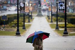 April 12, 2018 - Toronto, ON, Canada - TORONTO, ON - APRIL 12  -   .A man walks in front of Queen's Park during a rainy day in Toronto. .April 12, 2018. Carlos Osorio/Toronto Star (Credit Image: © Carlos Osorio/The Toronto Star via ZUMA Wire)