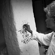 A supervisor adds his own marking on the house wall of a house as a follow up after the teams during vaccination day at a village on the flood plains of the Kosi river near Kusheshwar Asthan (E), Bihar.