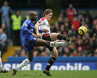 Photo: Lee Earle.<br /> Chelsea v Fulham. The Barclays Premiership. 26/12/2005. Chelsea's William Gallas (L) battles with Heidar Helguson for the ball.