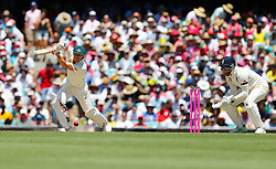 Australia's David Warner hits a shot as Jonny Bairstow looks on during day two of the Ashes Test match at Sydney Cricket Ground.