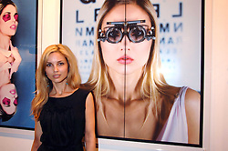 Model SOPHIA PUNCOCHAROVA in front of a photograph of her at the launch of 'Glenmorangie 5 Senses' an exhibition of photographs by Mike Figgis held at Proud Camden, Stables Market, London NW1 on 13th May 2008.<br /><br />NON EXCLUSIVE - WORLD RIGHTS