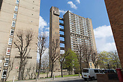 Carradale House next to Balfron Tower on 27th April 2016 in London, United Kingdom. The architecturally important Balfron Tower is a 26-storey residential building in Poplar, a district of the London Borough of Tower Hamlets in the East End of London. It was designed by Ernő Goldfinger and built in a brutalist style for the London Country Council. It and opened in 1967. The tower forms part of the Brownfield Estate. It has been a Grade II listed building since 1996. Balfron Tower is stylistically similar to Goldfingers later Trellick Tower in West London. Recently, residents and campaigners are battling to prevent a regeneration of the celebrated tower.
