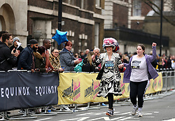 A runner dressed as a pearly queen during the 2018 London Landmarks Half Marathon. PRESS ASSOCIATION Photo. Picture date: Sunday March 25, 2018. Photo credit should read: Steven Paston/PA Wire