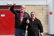 Two Middlesbrough fans one in a mask outside the Riverside stadium ahead of the EFL Sky Bet Championship match between Middlesbrough and Bournemouth at the Riverside Stadium, Middlesbrough, England on 19 September 2020.