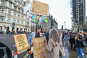 A climate activist aiming to raise awareness on plastic pollution stands across the street in Parliament Square facing House of Commons as British Prime Minister Boris Johnson shook up his government on Thursday, firing and appointing ministers to key Cabinet posts. Johnson was aiming to tighten his grip on the government after winning a big parliamentary majority in December's election. That victory allowed Johnson to take Britain out of the European Union in January. (Photo/Vudi Xhymshiti)